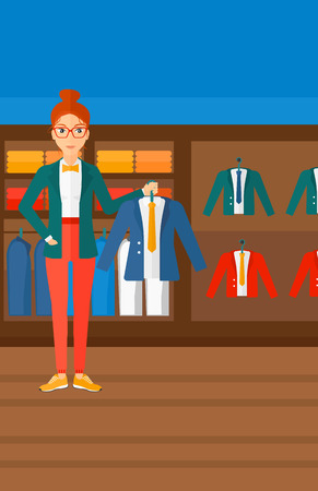 A woman holding a hanger with a jacket on the background of clothes store vector flat design illustration. Vertical layout.