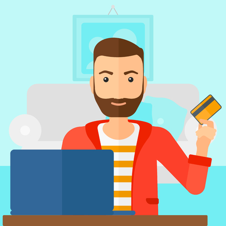 A hipster man with the beard sitting in front of laptop with credit card in hand and making purchases online on the background of living room vector flat design illustration. Square layout.