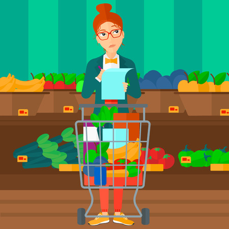 supermarket trolley: A thoughtful woman standing with full supermarket trolley and holding a shopping list in hands on the background of shelves with vegetables and fruits in supermarket vector flat design illustration. Square layout.