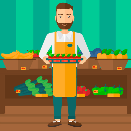 A hipster man with the beard holding a box with apples on the background of shelves with vegetables and fruits in supermarket vector flat design illustration. Square layout. Vettoriali