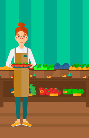 A woman holding a box with apples on the background of shelves with vegetables and fruits in supermarket vector flat design illustration. Vertical layout.