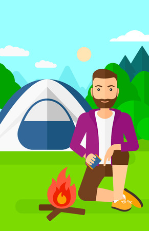 A hipster man with the beard kindling a fire on the background of camping site with tent vector flat design illustration. Vertical layout.