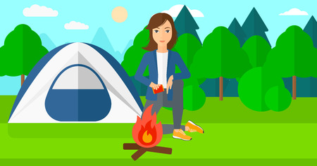 forest trees: A woman kindling a fire on the background of camping site with tent vector flat design illustration. Horizontal layout.