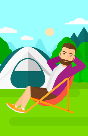 A hipster man with the beard sitting in a folding chair on the background of camping site with tent vector flat design illustration. Vertical layout.