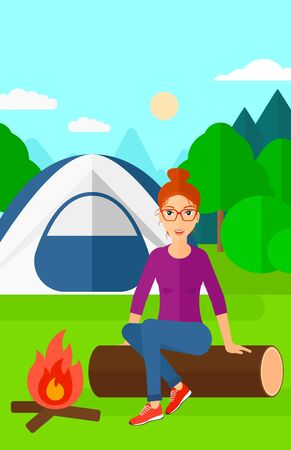 A woman sitting on a log near the fire on the background of camping site with tent vector flat design illustration. Vertical layout.