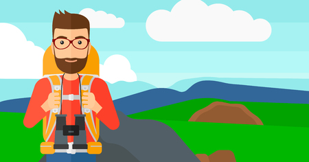 A hipster man with backpack and binoculars hiking on the background of hilly countryside vector flat design illustration. Horizontal layout. Stock Illustratie