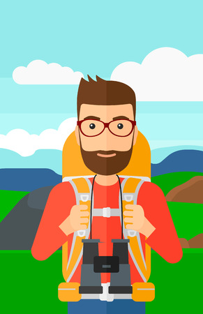 A hipster man with backpack and binoculars hiking on the background of hilly countryside vector flat design illustration. Vertical layout. Imagens - 52368594