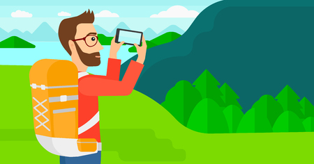 A hipster man with the beard taking photo of landscape with mountains and lake vector flat design illustration. Horizontal layout.