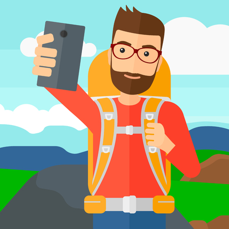 A hipster man with the beard making selfie on the background of hilly countryside vector flat design illustration. Square layout. Ilustração