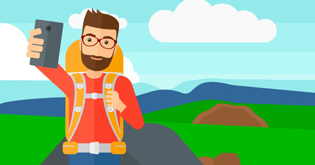 A hipster man with the beard making selfie on the background of hilly countryside vector flat design illustration. Horizontal layout. Imagens - 52368609
