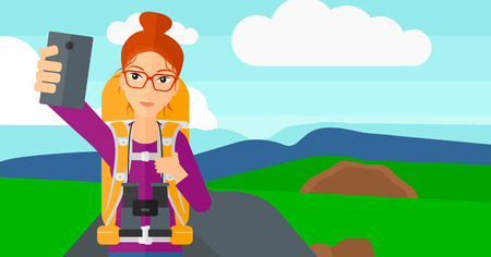 smart phone woman: A woman making selfie on the background of hilly countryside vector flat design illustration. Horizontal layout.