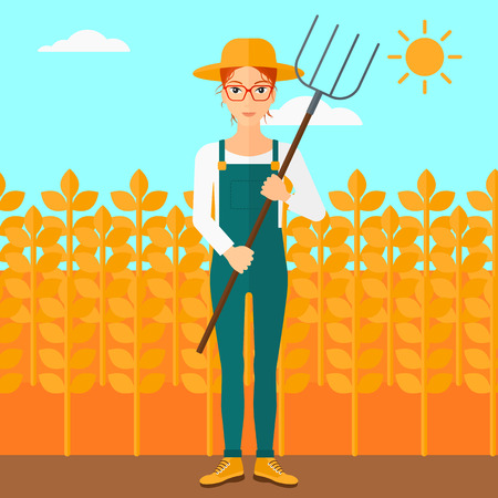 A woman standing with a pitchfork on the background of wheat field vector flat design illustration. Square layout.