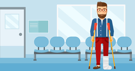 An injured hipster man with broken leg standing with crutches on the background of hospital corridor vector flat design illustration. Horizontal layout.
