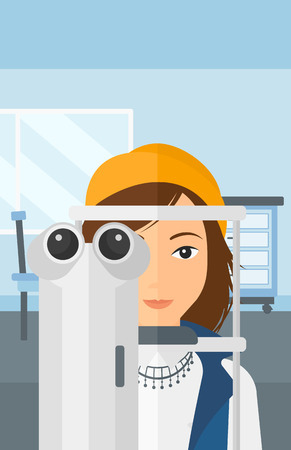 A woman during eye examon the background of medical office vector flat design illustration. Vertical layout.
