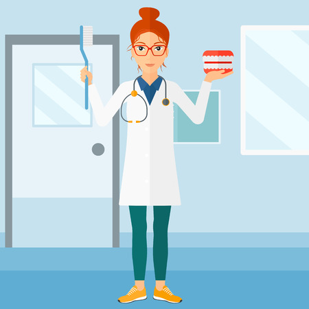 A woman with a dental jaw model and a toothbrush on a polyclinic background vector flat design illustration. Square layout. Illusztráció