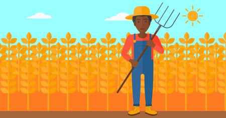 rancher: An african-american man standing with a pitchfork on the background of wheat field vector flat design illustration. Horizontal layout.