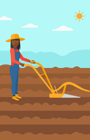 furrow: An african-american woman using a plough on the background of plowed agricultural field vector flat design illustration. Vertical layout.