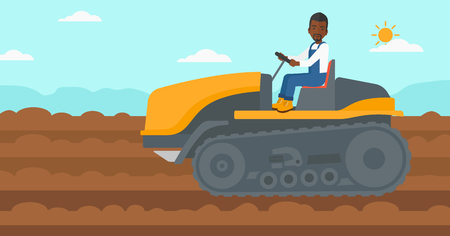 An african-american man driving a catepillar tractor on a background of plowed agricultural field vector flat design illustration. Horizontal layout. Illustration