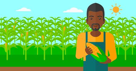 Un homme afro-américain tenant un épi de maïs sur le fond de vecteur champ design plat illustration. Présentation horizontale.