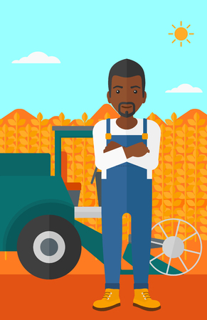 harvesting: An african-american man standing on the background of combine harvesting wheat vector flat design illustration. Vertical layout. Illustration