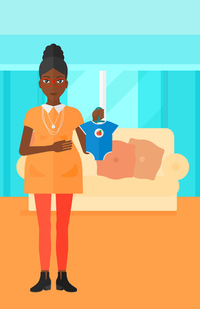 An african-american pregnant woman holding clothes for her baby on the background of living room vector flat design illustration. Vertical layout.