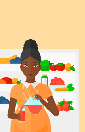 fruit drink: An african-american pregnant woman pouring juice in a glass on the background of  refrigerator full of fruits and vegetables vector flat design illustration. Vertical layout. Illustration