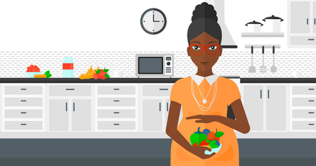 An african-american pregnant woman holding a bowl with vegetables on a kitchen background vector flat design illustration. Horizontal layout.