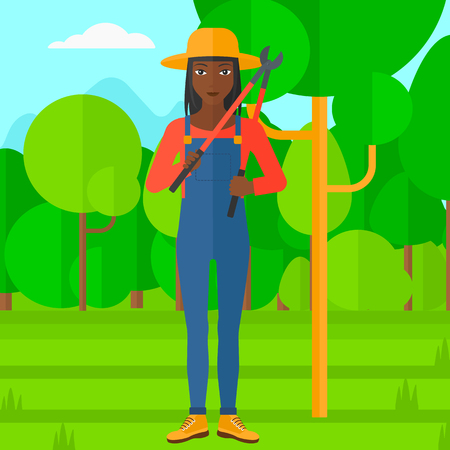 big cartoon: An african-american woman holding a pruner on a background of garden with trees vector flat design illustration. Square layout.