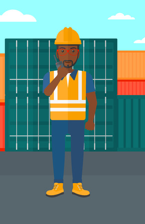An african-american man talking to a portable radio on cargo containers background vector flat design illustration. Vertical layout. Illustration