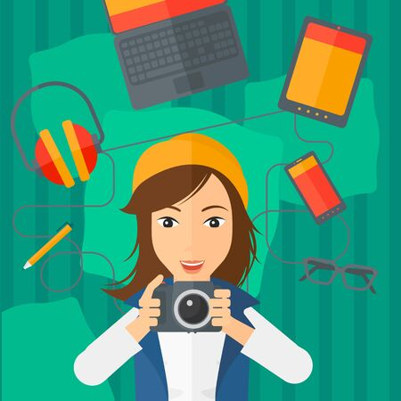 smart phone woman: A woman holding a camera on a green background with gadgets vector flat design illustration. Square layout.