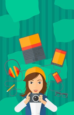 smart phone woman: A woman holding a camera on a green background with gadgets vector flat design illustration. Vertical layout.