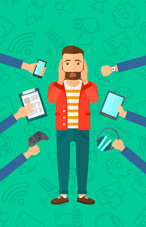 A hipster man in despair and many hands with gadgets  around him on a green background with technology icons vector flat design illustration. Vertical layout.