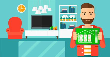 A hipster man with the beard holding a tablet computer with smart home application on a screen on the background of modern  living room vector flat design illustration. Horizontal layout. Illusztráció