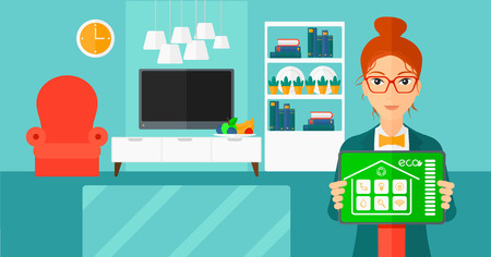 A woman holding a tablet computer with smart home application on a screen on the background of modern  living room vector flat design illustration. Horizontal layout. Illusztráció