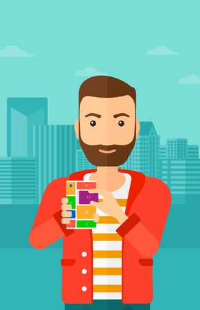 repurpose: A hipster man with the beard holding modular phone on a city background vector flat design illustration. Vertical layout.
