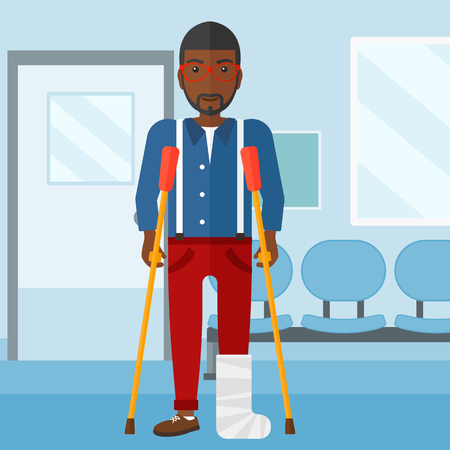 An african-american man with broken leg standing with crutches on the background of hospital corridor vector flat design illustration. Square layout. Stock Illustratie