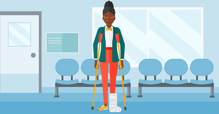 An african-american woman with broken leg standing with crutches on the background of hospital corridor vector flat design illustration. Horizontal layout.