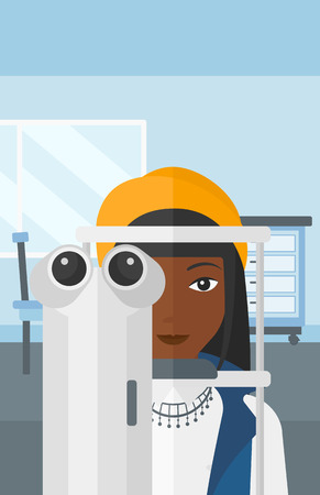 An african-american woman during eye examon the background of medical office vector flat design illustration. Vertical layout.