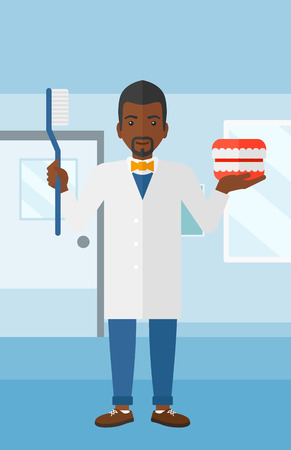 polyclinic: An african-american man with a dental jaw model and a toothbrush on a polyclinic background vector flat design illustration. Vertical layout.