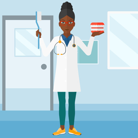 polyclinic: An african-american woman with a dental jaw model and a toothbrush on a polyclinic background vector flat design illustration. Square layout. Illustration