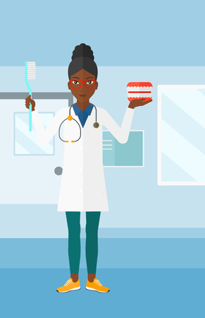 An african-american woman with a dental jaw model and a toothbrush on a polyclinic background vector flat design illustration. Vertical layout.