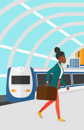 arriving: An african-american woman walking on the platform on the background of modern train arriving at the station vector flat design illustration. Vertical layout.
