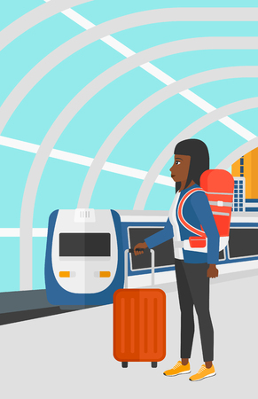 arriving: An african-american woman standing with suitcase on wheels and holding a briefcase in hand on the background of modern train arriving at the station vector flat design illustration. Vertical layout.