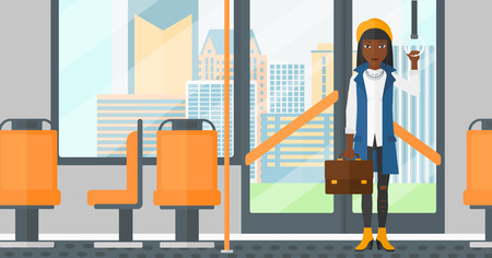 handgrip: An african-american woman with a suitcase standing inside public transport vector flat design illustration. Horizontal layout.