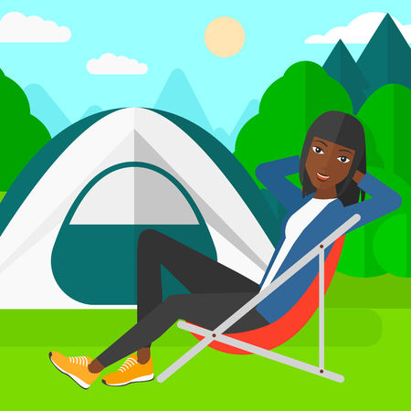 cartoon park: An african-american woman sitting in a folding chair on the background of camping site with tent vector flat design illustration. Square layout. Illustration
