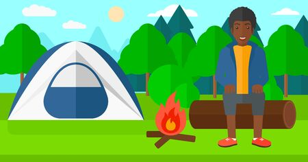 An african-american man sitting on a log near the fire on the background of camping site with tent vector flat design illustration. Horizontal layout. Vettoriali