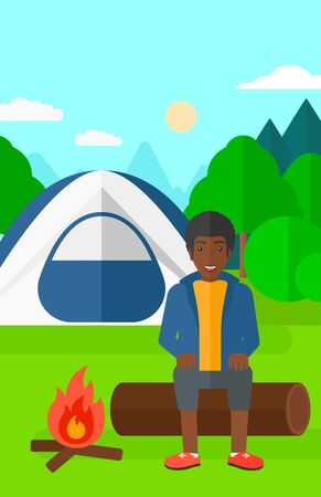 An african-american man sitting on a log near the fire on the background of camping site with tent vector flat design illustration. Vertical layout.