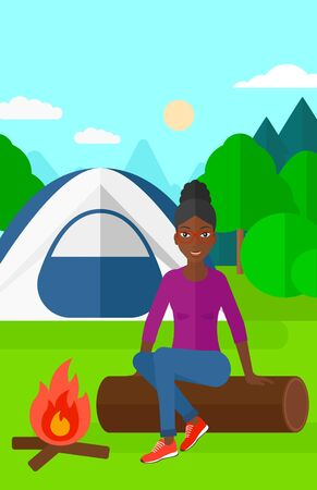 forest trees: An african-american woman sitting on a log near the fire on the background of camping site with tent vector flat design illustration. Vertical layout.