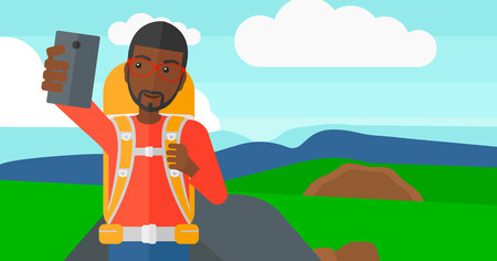 An african-american man making selfie on the background of hilly countryside vector flat design illustration. Horizontal layout.