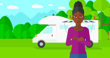 motorhome: An african-american woman standing on the background of motorhome in the forest vector flat design illustration. Horizontal layout. Illustration